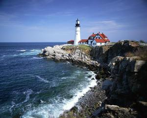 Lighthouse on a Rocky Coastline