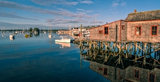 Harbor with rustic fishing shack and pier in Maine